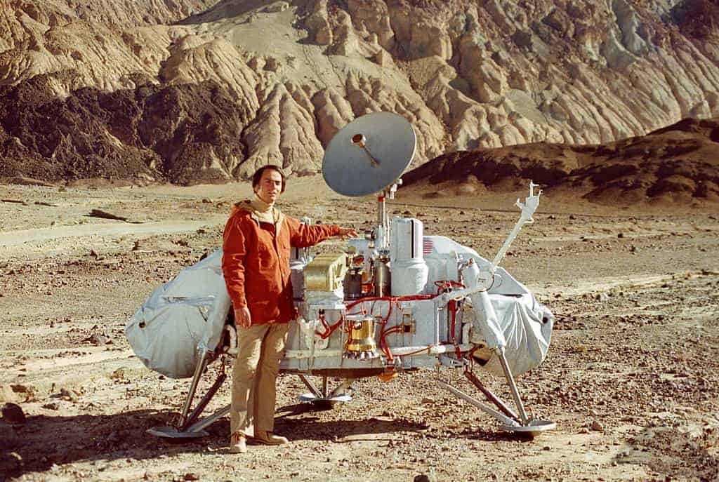 Sagan with a model of the Viking lander that would land on Mars. Sagan examined possible landing sites for Viking along with Mike Carr and Hal Masursky.