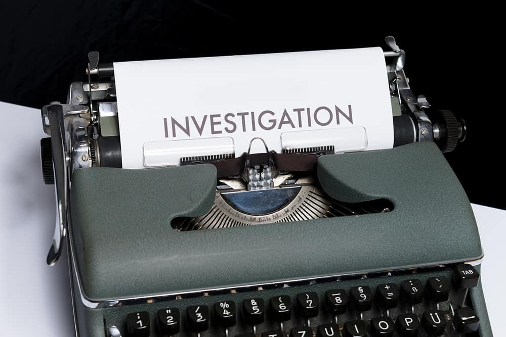 Typewriter showing page with text: investigation